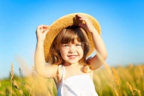 Kind mit Sonnenhut