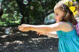 Mädchen hat Krone auf, Seifenblasen