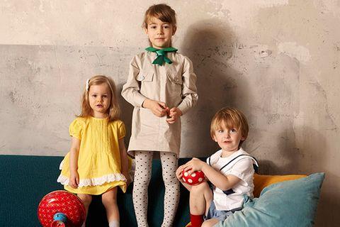 Drei Kinder in ELTERN-Dior-Modellen
