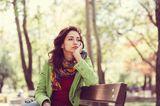 Frau auf der Parkbank