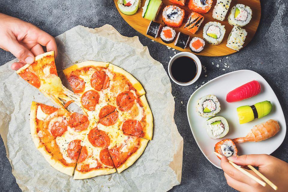 Pizza und Sushi gehören zu den Lebensmitteln, auf die viele Frauen nach der Geburt Hunger haben